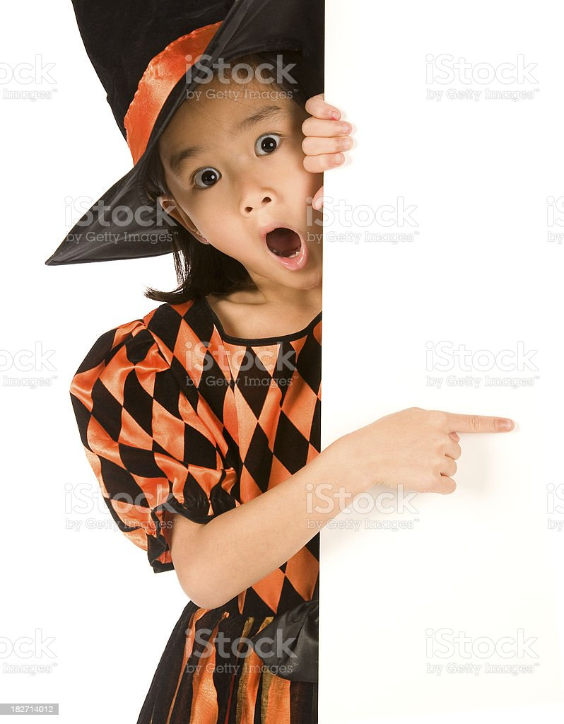 Surprised witch pointing to blank sign royalty-free stock photo