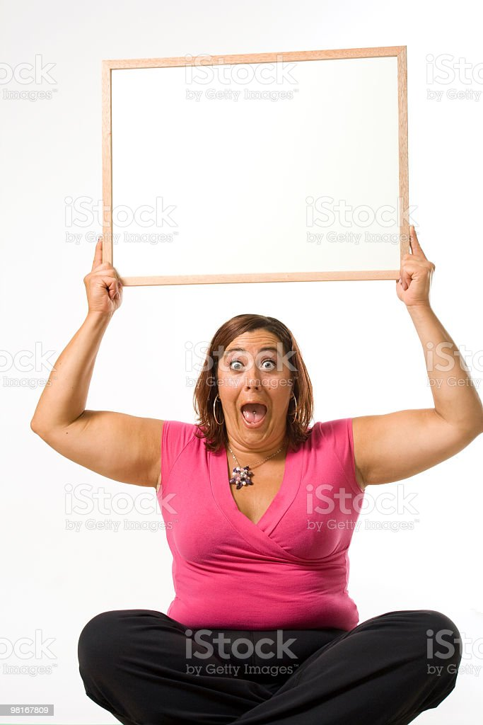 Surprised woman holding a sign above her head royalty-free stock photo