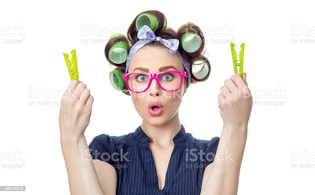 Surprised woman holding clothespin stock photo