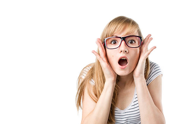Surprised woman in glasses stock photo