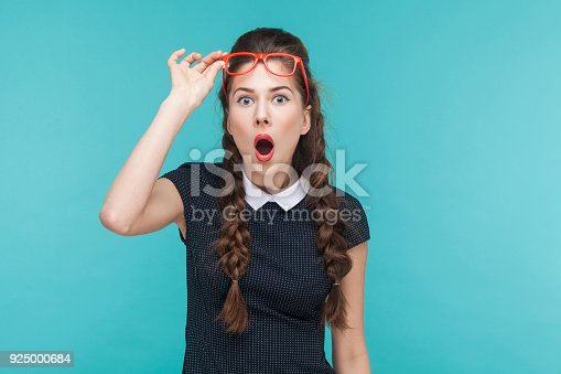istock Surprised woman in red glasses amazement looking at camera 925000684