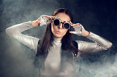 istock Surprised Woman in Silver Costume and Steampunk Glasses 537334920