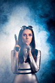 istock Surprised Woman in Silver Space Costume Holding Pistol Gun 537334938