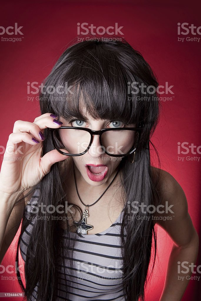 Surprised Woman Looking Over Nerd Glasses stock photo