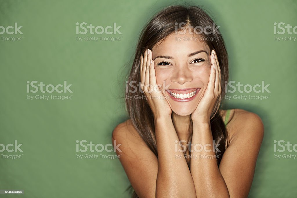 Surprised woman on green background. royalty-free stock photo