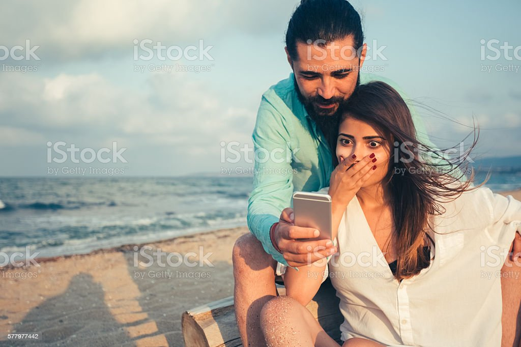 Surprised woman on the beach stock photo