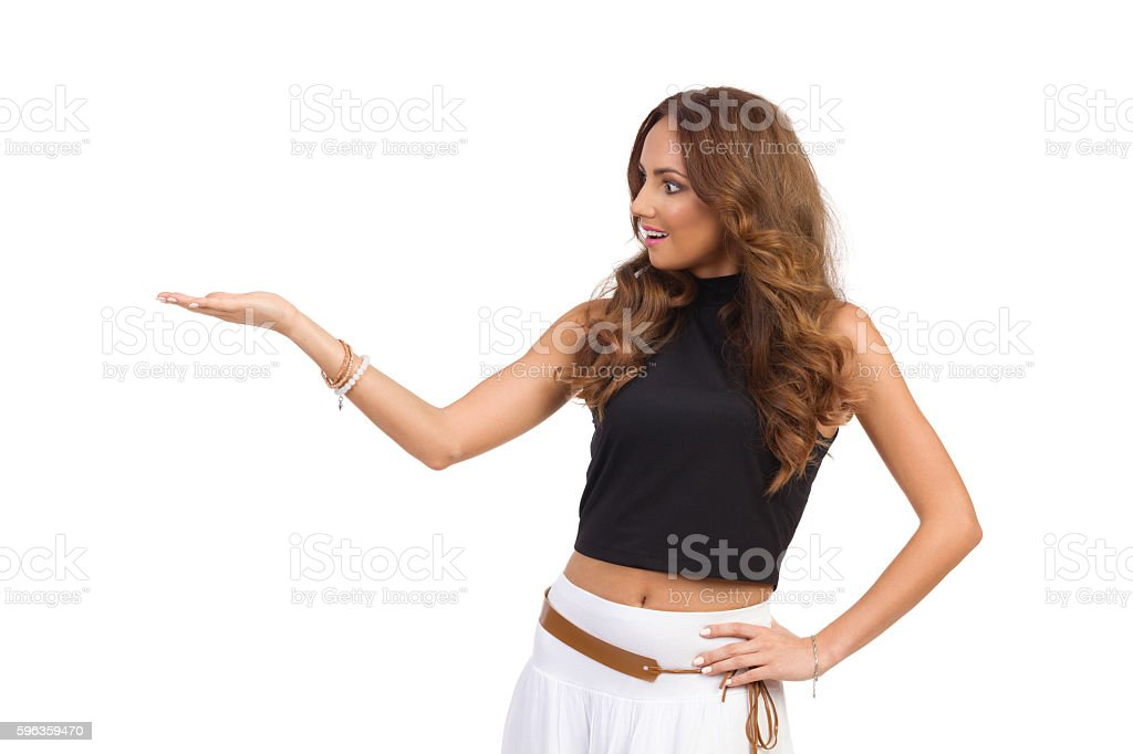 Surprised Woman Presenting Something royalty-free stock photo