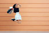istock Surprised Woman Running With Shopping Bags in Summer Sale Season 814271228