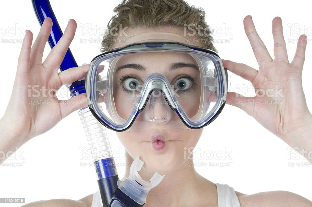 Surprised woman, scuba mask and snorkel, makes funny fish face stock photo