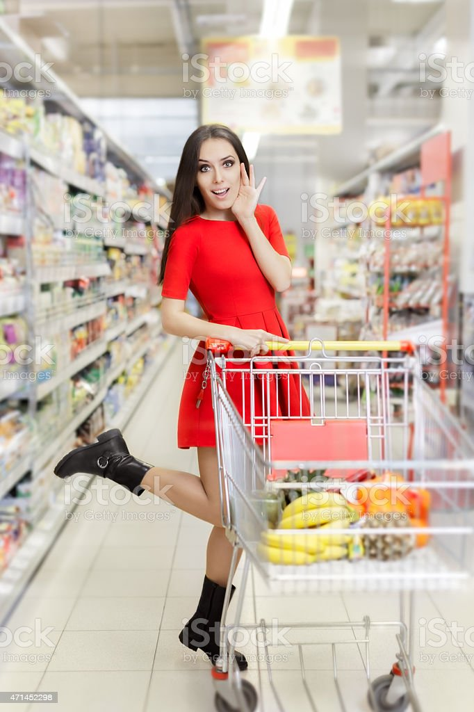 Surprised Woman Shopping  at The Supermarket stock photo