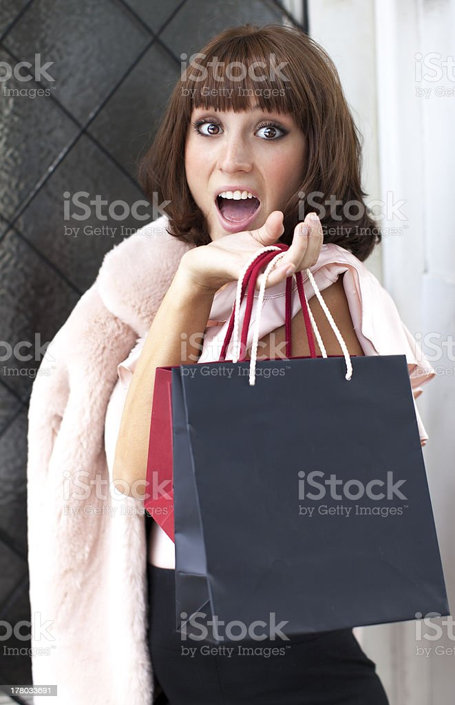 Surprised woman with bags royalty-free stock photo