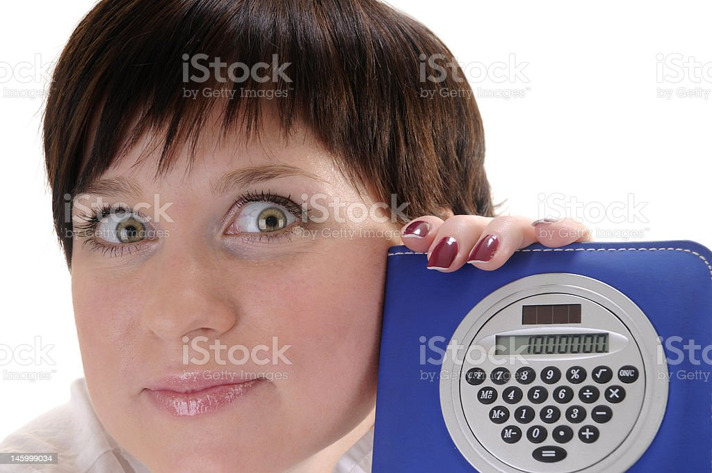 Surprised woman with calculator stock photo