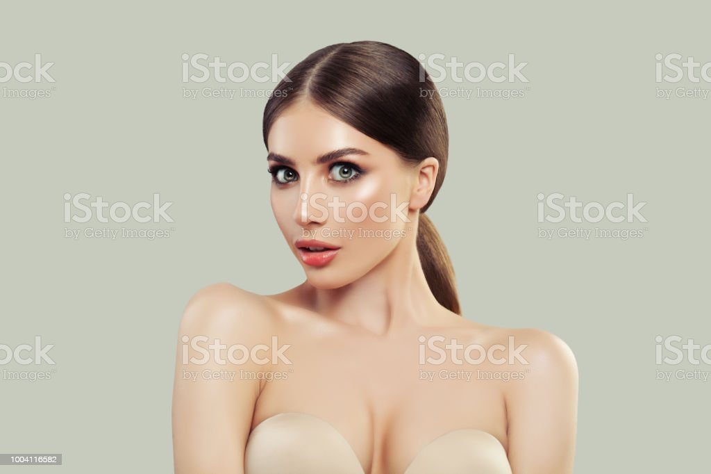 Surprised Woman with Clear Skin and Brown Hair Portrait. Surprised...