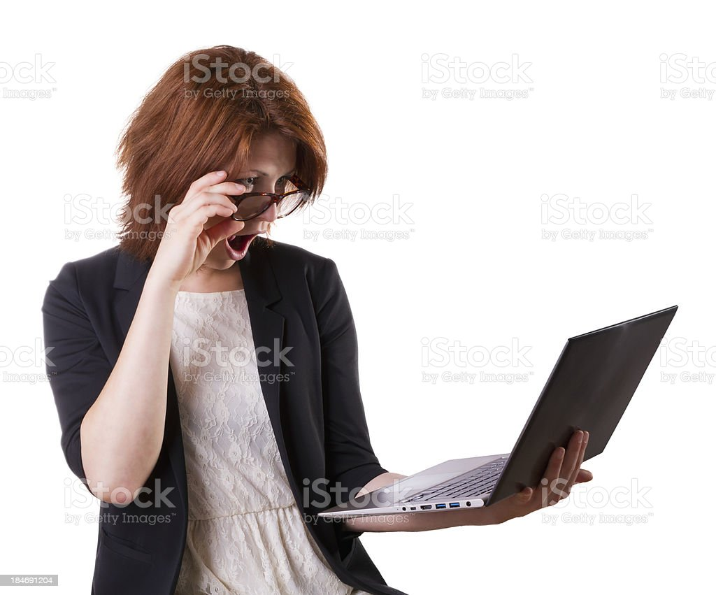 Surprised woman with laptop royalty-free stock photo