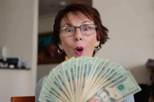 Surprised woman with money picture id1190526281?b=1&k=6&m=1190526281&s=612x612&w=0&h=2ltt3sjzmrhud44mo9amoxtxbjtsq3uiuxrwnjwvoc8=