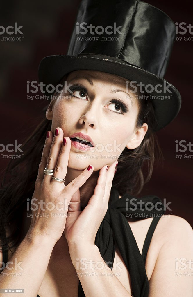 Surprised woman with stovepipe hat stock photo
