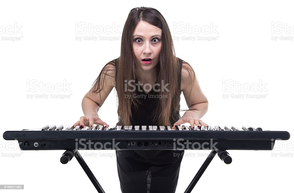 Surprised woman with synthesizer stock photo