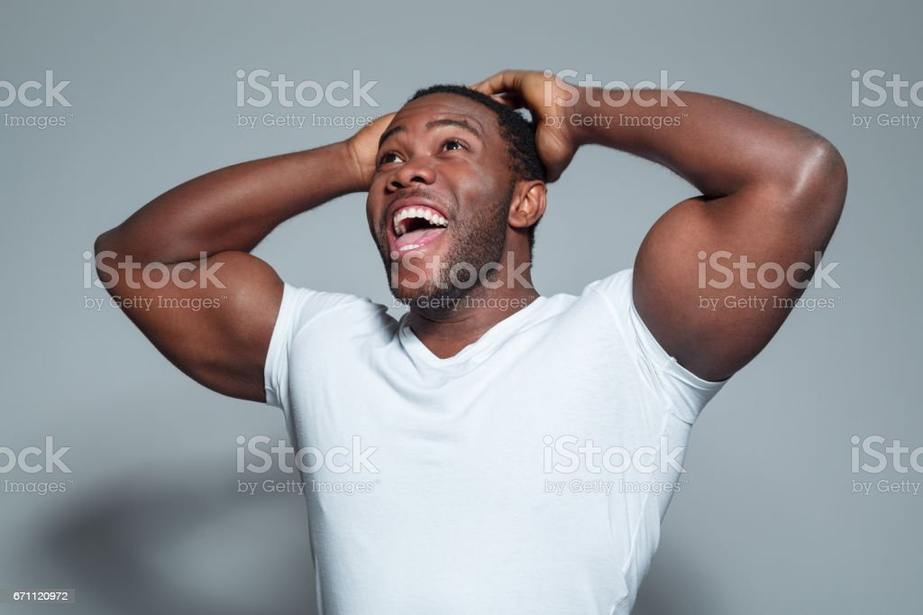 Surprised young african american man stock photo