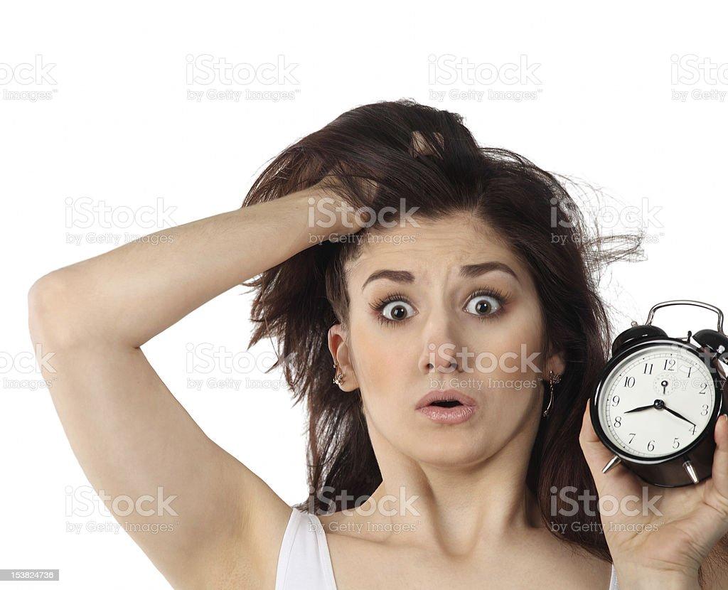 Surpresa Jovem mulher com relógio brunette - foto de acervo