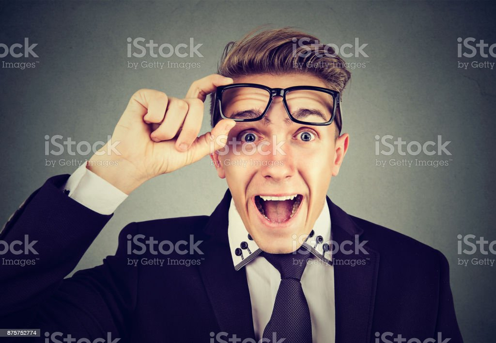 Surprised young business man with glasses stock photo