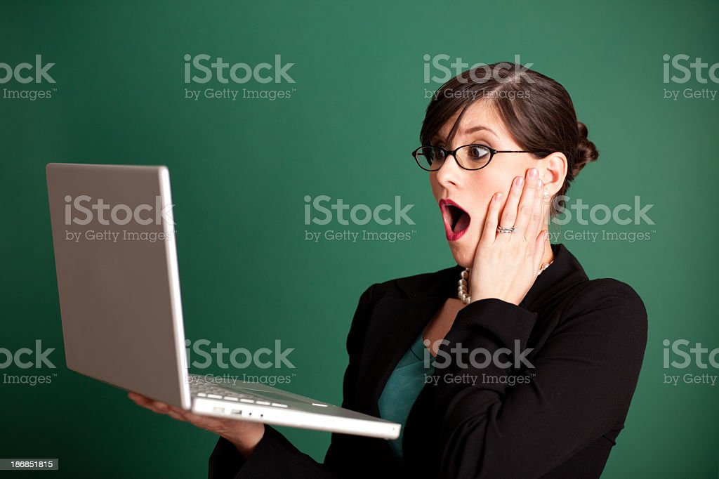 Surprised Young Business Woman Holding Laptop Computer royalty-free stock photo