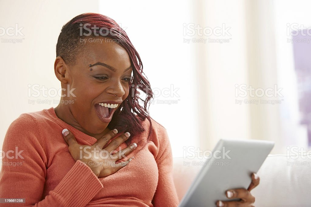 Surprised young lady using digital tablet royalty-free stock photo