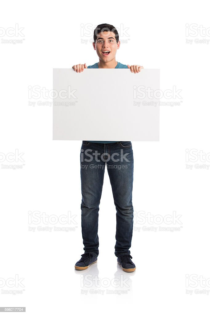 Surprised young man holding blank sign foto royalty-free