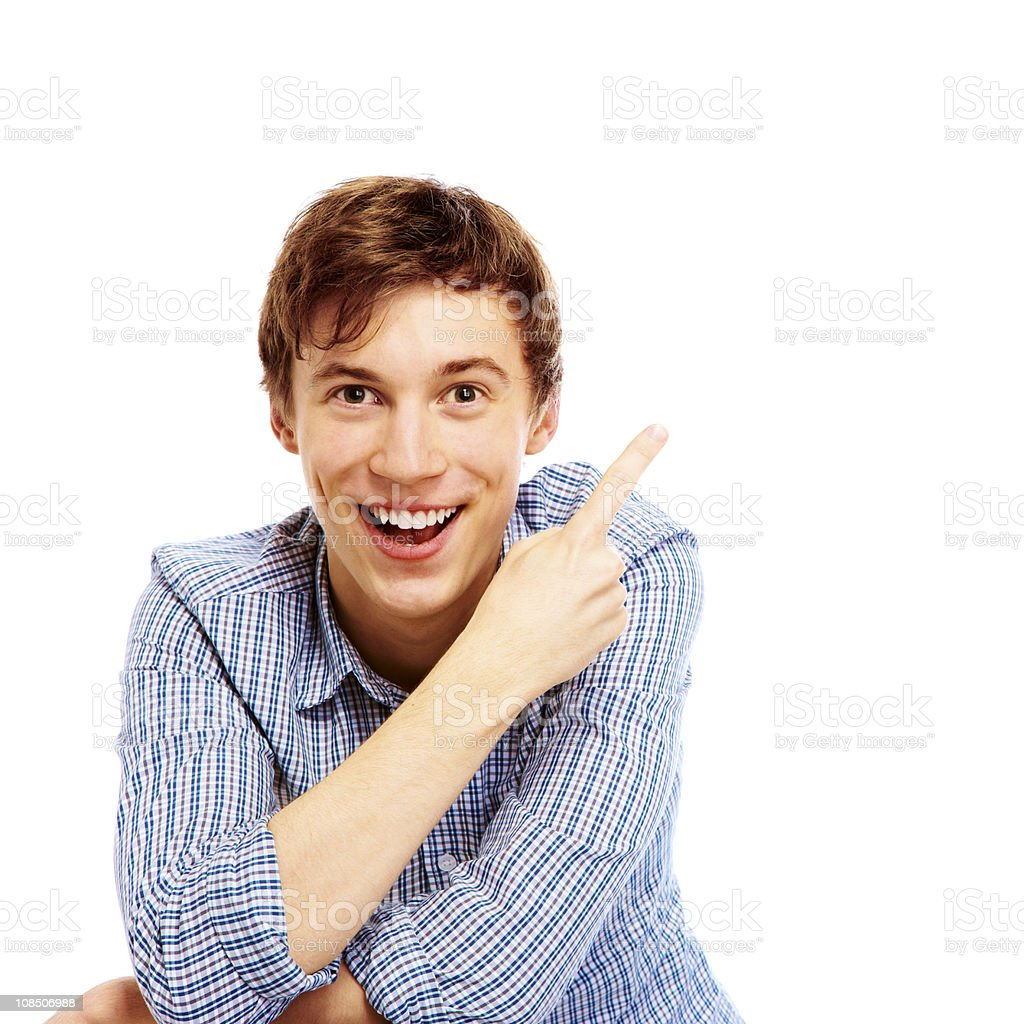 surprised young man pointing to corner over white background royalty-free stock photo