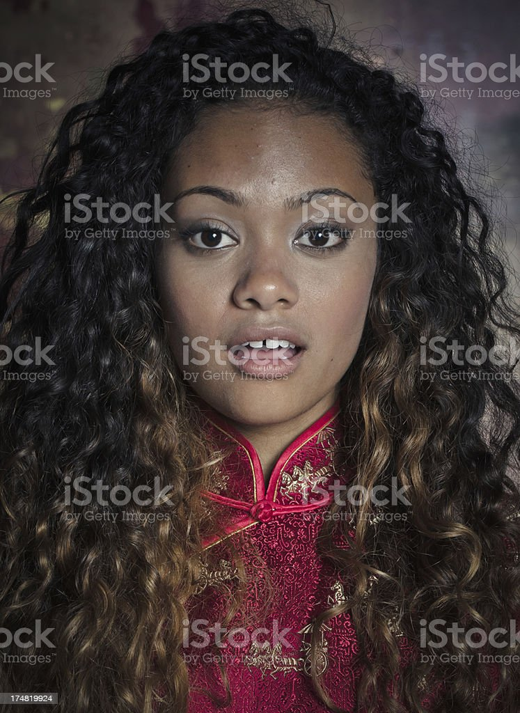 Surprised Young Woman With Curly Hair royalty-free stock photo