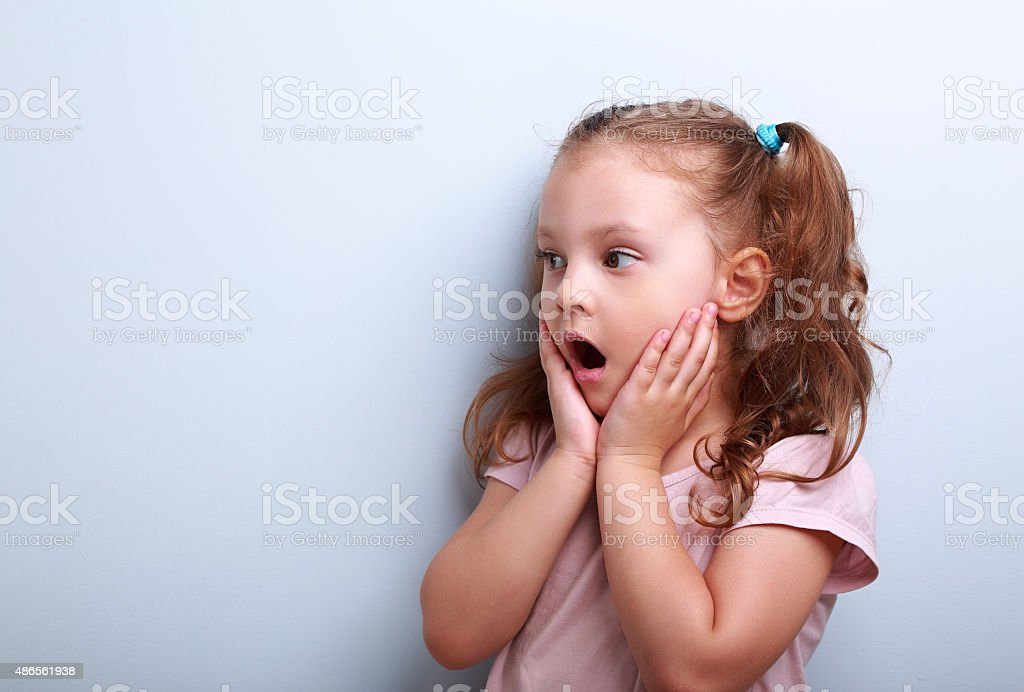 Surprising kid girl with opened mouth stock photo