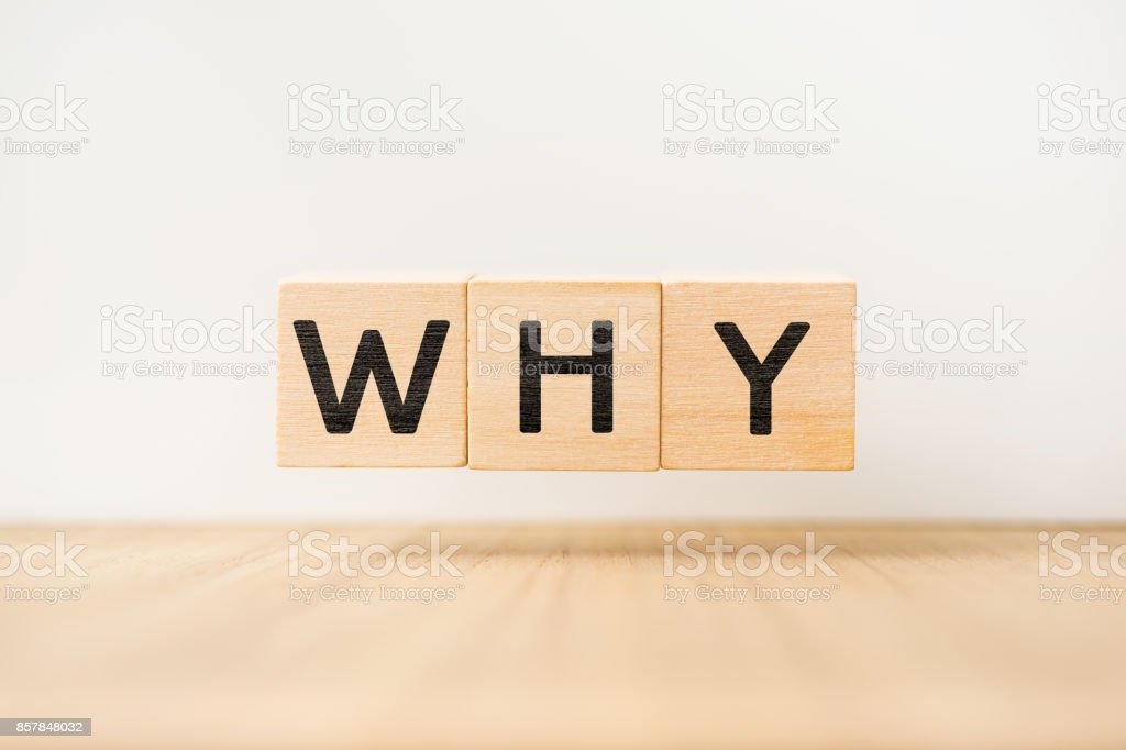 Surreal abstract geometric floating wooden cube with vocabulary 'WHY' stock photo