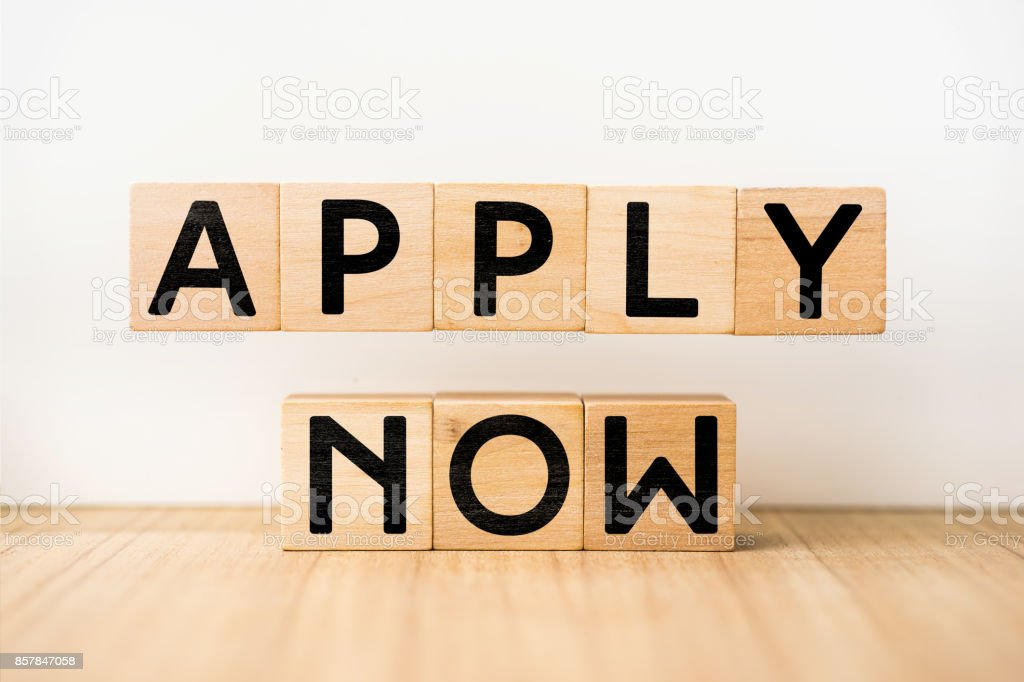 Surreal abstract geometric floating wooden cube with word ' APPLY NOW ' concept stock photo