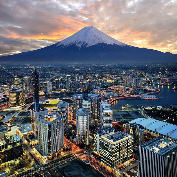 surreal aerial view of yokohama and mount fuji - tokyo japan stock photos and pictures