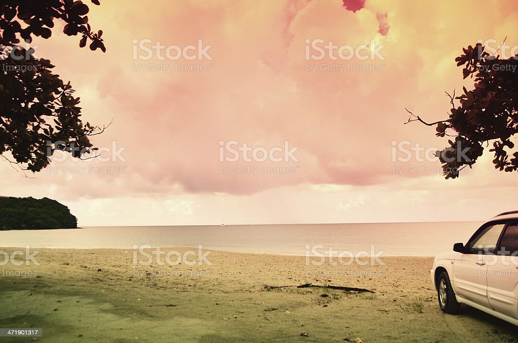 surreal beach scene with car royalty-free stock photo