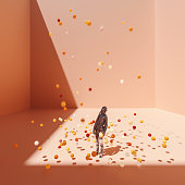 Surreal bent astronaut in cubic room with falling spheres.