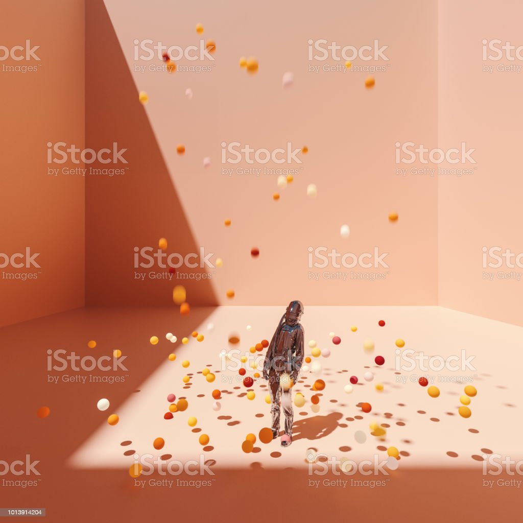 Surreal bent astronaut in cubic room with falling spheres stock photo