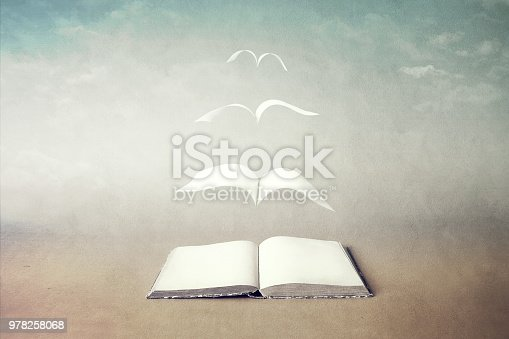 istock surreal book concept pages flying out of book 978258068