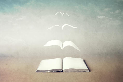 surreal book concept pages flying out of book