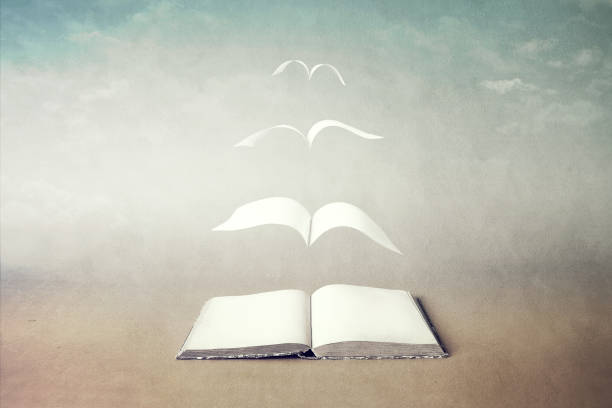 surreal book concept pages flying out of book stock photo