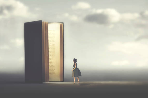 surreal book opens a door illuminated to a woman, concept of way to freedom stock photo