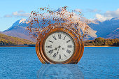 surreal broken clock in the lake