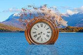 surreal broken clock in the lake
