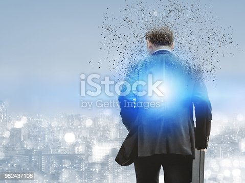 861862204 istock photo Surreal businessman in modern city. 982437108