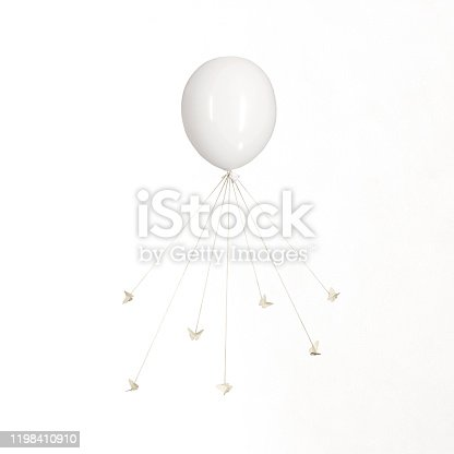 861862204 istock photo surreal carousel of butterflies that are tied to wires and dance and command a balloon 1198410910