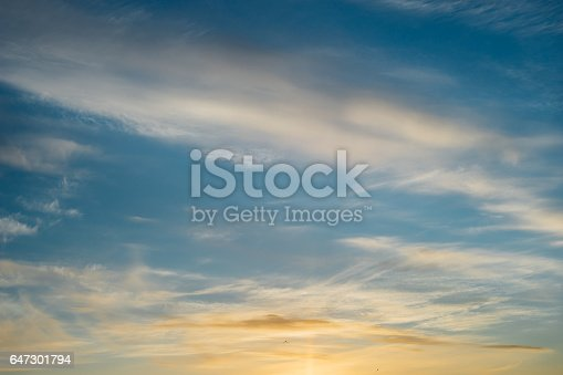 istock Surreal cirrus clouds on deep blue evening sky 647301794