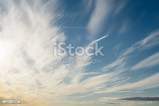 istock Surreal cirrus clouds on deep blue morning sky 647301776