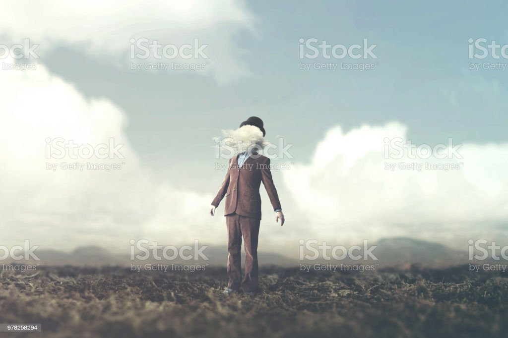surreal concept head in the clouds stock photo