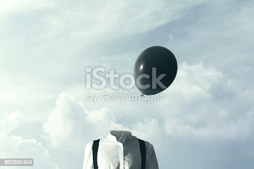 861862204 istock photo surreal concpet big black balloon blowing in the wind 862650404