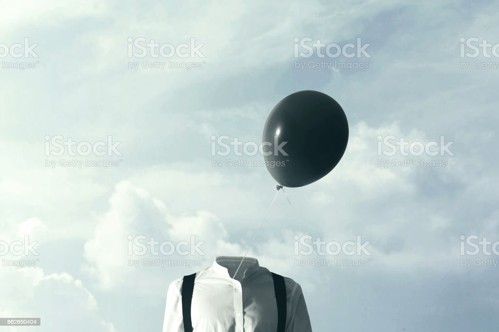 surreal concpet big black balloon blowing in the wind stock photo