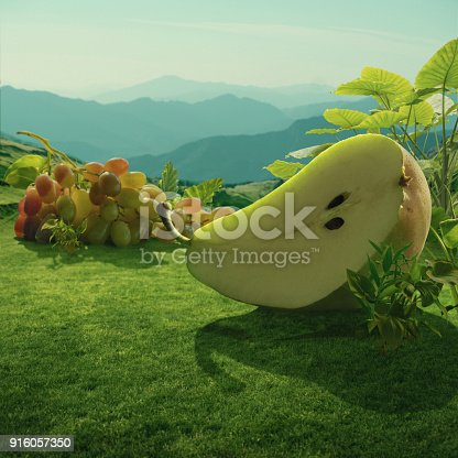 Surreal giant pear and grapes at mountain field